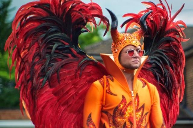 Taron Egerton as Elton John in a devil suit